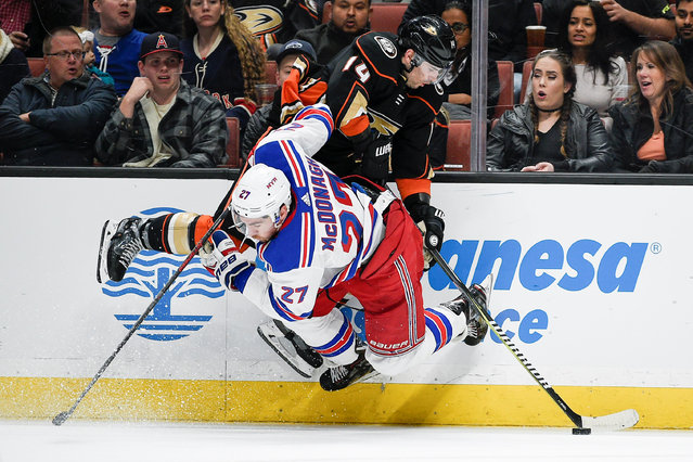 New York Rangers defenseman Ryan McDonagh (27) checks Anaheim Ducks center Adam Henrique (14) into the boards during the second quarter at Honda Center in Anaheim, CA, USA on January 23, 2018. (Photo by Kelvin Kuo/USA TODAY Sports)