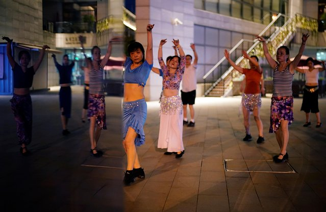 People dance on the street, following the coronavirus disease (COVID-19) outbreak in Wuhan, Hubei province, China on September 2, 2020. (Photo by Aly Song/Reuters)