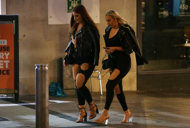 Two women out in Cardiff, England on September 19, 2020. Revellers enjoyed a night out on Saturday in what could be the last weekend of freedom before another national lockdown is announced to stop the spread of Covid-19. (Photo by Huw Evans Picture Agency/The Sun)