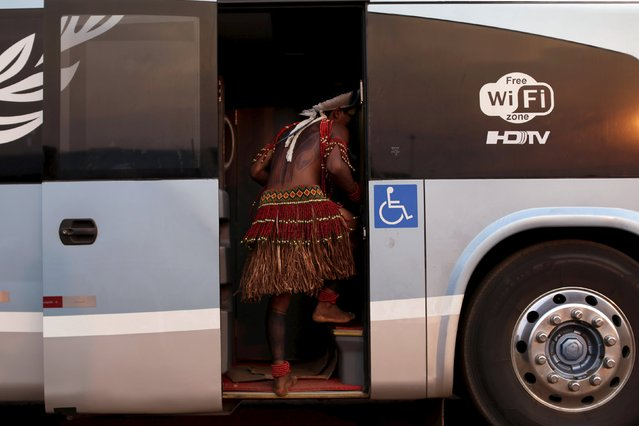A indigenous man from the Pataxo tribe enters a bus after arriving to participate in the I World Games for Indigenous People in Palmas, Brazil, October 20, 2015. (Photo by Ueslei Marcelino/Reuters)