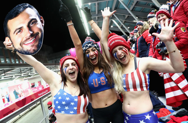 Fans of Chris Mazdzer of the United States including his girlfriend Mara Marian (C) react following his third run during the Luge Men's Singles on day two of the PyeongChang 2018 Winter Olympic Games at Olympic Sliding Centre on February 11, 2018 in Pyeongchang-gun, South Korea. (Photo by Alexander Hassenstein/Getty Images)