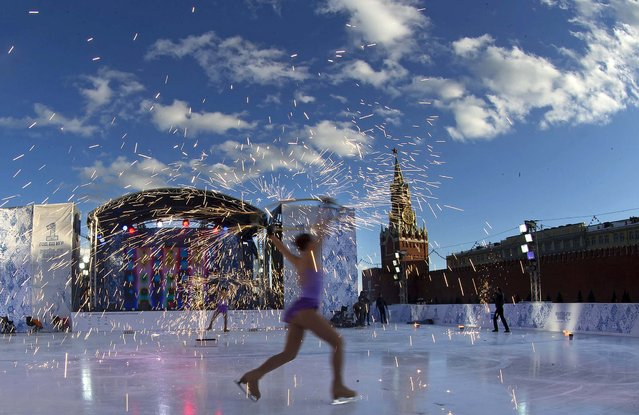 Skaters perform during celebrations launching the one-year countdown for the 2014 Sochi Winter Paralympics in Moscow's Red Square, on March 7, 2013. (Photo by Alexander Zemlianichenko/Associated Press)