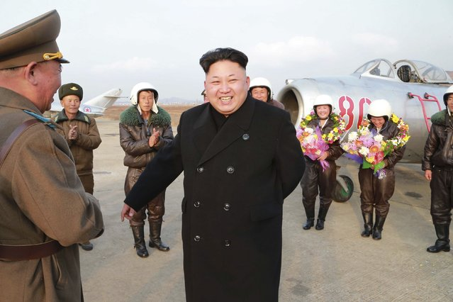 North Korean leader Kim Jong Un smiles as he provides field guidance to the flight drill of female pilots of pursuit planes of the KPA Air and Anti-Air Force in this undated photo released by North Korea's Korean Central News Agency (KCNA) in Pyongyang November 28, 2014. (Photo by Reuters/KCNA)