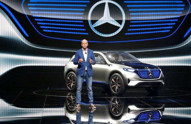 Dieter Zetsche, CEO of Daimler and Head of Mercedes-Benz, attends a news conference in front of a Mercedes EQ Electric car on media day at the Mondial de l'Automobile, the Paris auto show, in Paris, France, September 29, 2016. (Photo by Jacky Naegelen/Reuters)