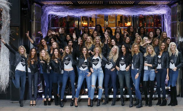 Models pose for a group photograph outside the Victoria's Secret shop on New Bond Street in central London, December 1, 2014. (Photo by Andrew Winning/Reuters)