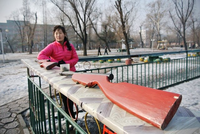 A North Korean amusement park vendor waits for customers in the northeastern North Korean border town of Sinuiju, on December 15, 2012. (Photo by Wang Zhao/AFP Photo)
