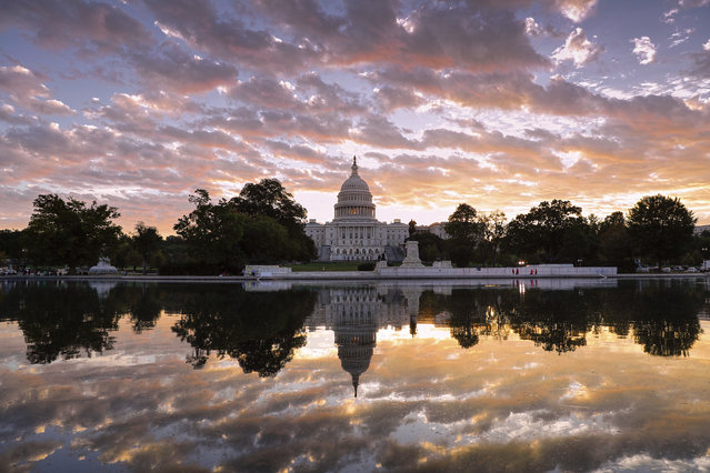 The Capitol is seen at sunrise, in Washington, Tuesday, October 10, 2017. (Photo by J. Scott Applewhite/AP Photo)
