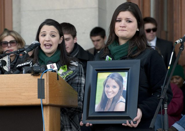 Jillian Soto, sister of Sandy Hook Elementary School shooting victim Victoria Soto, left, speaks as her cousin Heather Cronk, right, holding photograph of Soto, listens, during a rally at the Capitol in Hartford, Conn., Thursday, February 14, 2013. Thousands of people turned out to call on lawmakers to toughen gun laws in light of the December elementary school shooting in Newtown that left 26 students and educators dead. (Photo by Jessica Hill/AP Photo)