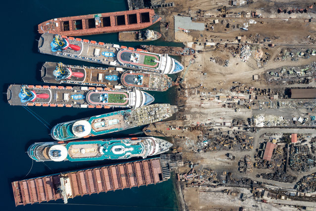 In this aerial view from a drone, five luxury cruise ships are seen being broken down for scrap metal at the Aliaga ship recycling port on October 02, 2020 in Izmir, Turkey. With the global coronavirus pandemic pushing the multi-billion dollar cruise industry into crisis, some cruise operators have been forced to cut losses and retire ships earlier than planned. The cruise industry has been one of the hardest hit industries with public confidence in cruise holidays plummeting after a series of outbreaks occurred on cruise liners as the pandemic spread. The crisis however has bolstered the years intake of ships at the Aliaga ship recycling port with business up thirty percent on the previous year. (Photo by Chris McGrath/Getty Images)