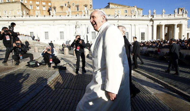 Pope Francis, who's 78th birthday is today, smiles as he arrives to lead his general audience at the Vatican, December 17, 2014. (Photo by Tony Gentile/Reuters)