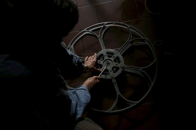 Projectionist Antonio Feliciano, 75, prepares a reel before a projection in Monforte, Portugal May 16, 2015. (Photo by Rafael Marchante/Reuters)