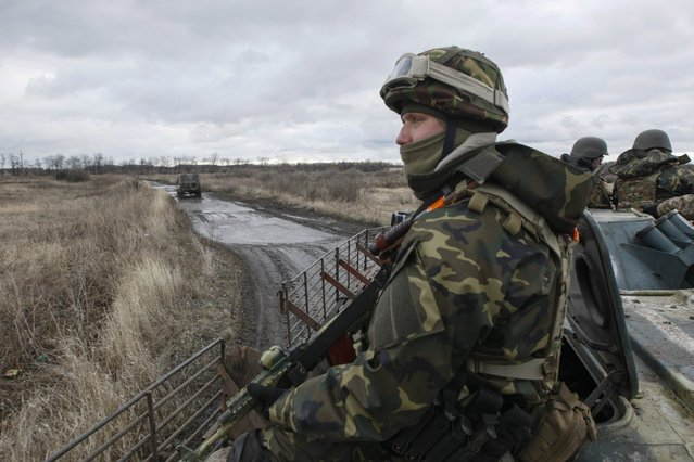 An Ukrainian serviceman rides on an armored personnel carrier (APC) as he patrols an area near the eastern Ukrainian town of Debaltseve in Donetsk region, December 24, 2014. (Photo by Valentyn Ogirenko/Reuters)
