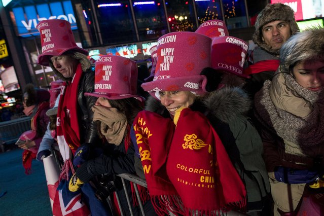 Revelers stand in the crowd in Times Square during New Year's Eve celebrations in New York   December 31, 2014. (Photo by Keith Bedford/Reuters)