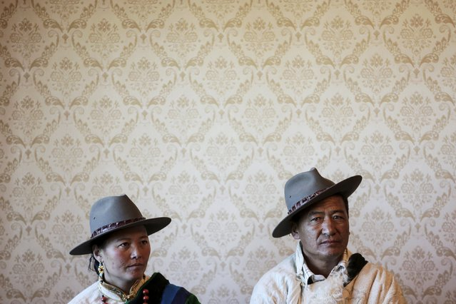 Tibetan herdsman Lob Sang (R) and his wife Lomo sit in their home while being visited by foreign reporters on a government organised tour in Damxung county of the Tibet Autonomous Region, China November 18, 2015. (Photo by Damir Sagolj/Reuters)