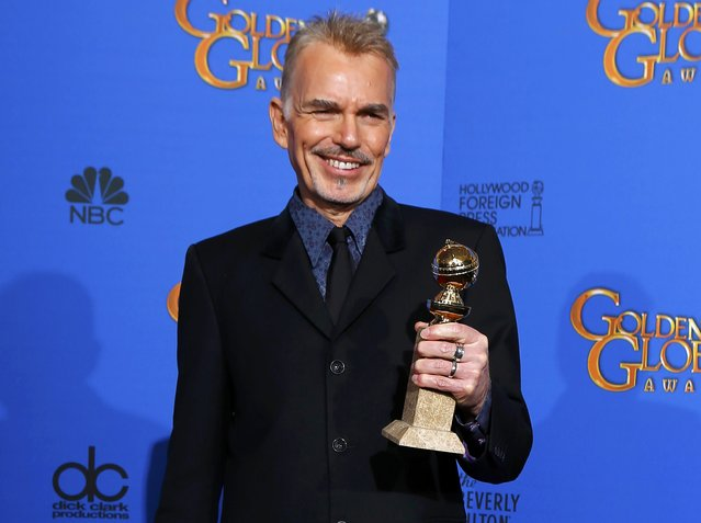 "Billy Bob Thorton poses with his award for Best Actor in a Mini-Series or TV Movie for his role in ""Fargo"" backstage at the 72nd Golden Globe Awards in Beverly Hills, California January 11, 2015. (Photo by Mike Blake/Reuters)"