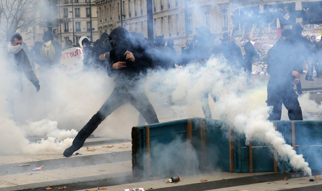 Activists clash with policemen during a protest ahead of the 2015 Paris Climate Conference, in Paris, Sunday, November 29, 2015. (Photo by Christophe Ena/AP Photo)