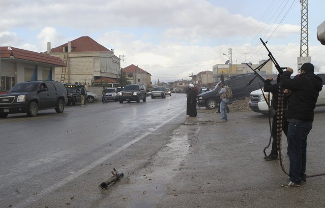 Unidentified gunmen fire their weapons in celebration as a convoy of officials escorting the newly released Lebanese soldiers and policemen who were captured by the al Qaeda-linked Nusra Front in Arsal, drive in Baalbek, in the Bekaa valley December 1, 2015. Al Qaeda's Syrian wing, the Nusra Front, released 16 Lebanese soldiers and policemen held captive since August, 2014 on Tuesday in a Qatari-mediated deal that also secured freedom for a jailed ex-wife of Islamic State leader Abu Bakr al-Baghdadi. (Photo by Ahmad Shalha/Reuters)