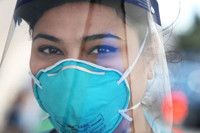 Registered Nurse Oli Meeta is seen wearing PPE (Personal Protective Equipment) at a Bondi Beach COVID-19 drive-through testing clinic on July 22, 2020 in Sydney, Australia. New South Wales recorded 16 new COVID-19 cases on Wednesday, bringing the state's total number of coronavirus cases to 3,425. NSW residents are being urged to avoid non-essential travel and large crowds, as health authorities work to contain several COVID-19 cluster outbreaks across the state. Cases linked to the Crossroads Hotel, Thai Rock and Batemans Bay Soldiers Club clusters have been shown to all be linked to virus strains in Victoria, where residents are currently in lockdown due to the dramatic rise in community transmissions. (Photo by Lisa Maree Williams/Getty Images)