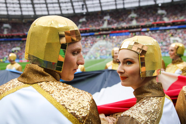 Fans pose before the Russia 2018 World Cup Group A football match between Russia and Saudi Arabia at the Luzhniki Stadium in Moscow on June 14, 2018. (Photo by Sergei Boblev/TASS via Getty Images)