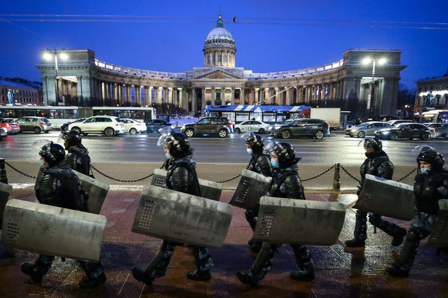 Riot police outside the Kazan Cathedral in Nevsky Avenue in St Petersburg, Russia on February 2, 2021. The city authorities tighten security measures as Moscow's court rules to convert Russian opposition activist Alexei Navalny's suspended sentence of three and a half years in the Yves Rocher case into a real jail term. (Photo by Peter Kovalev/TASS)