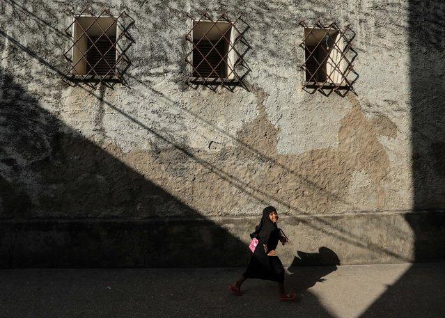 A young Zanzibari girl walks in an alleyway in the historical city of Stone Town, Zanzibar, Tanzania on on Wednesday, January 21, 2015. (Photo by Mosa'ab Elshamy/AP Photo)