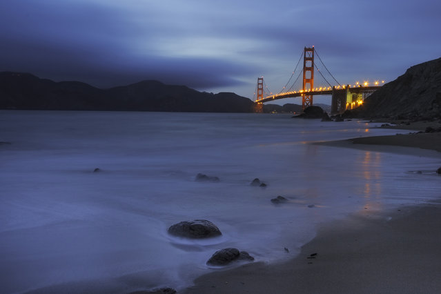 """""""Golden & Blue Hues"""". Shot during twilight at Marshal Beach with the Golden Gate bridge at the background which had just been lit up. Location: San Francisco, USA. (Photo and caption by Suvendu Das/National Geographic Traveler Photo Contest)"""