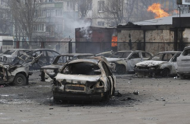 Burned cars on a destroyed parking site in a residential area in Mariupol, Ukraine, Saturday, January 24, 2015. (Photo by Sergey Vaganov/AP Photo)