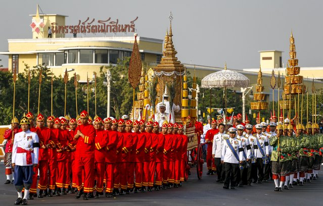 Officials take part in a procession with the royal carriage, containing the remains of Thailand's late Supreme Patriarch, Somdet Phra Nyanasamvara Somdet Phra Sangharaja, during his cremation ceremony in Bangkok, Thailand, December 16, 2015. Thai Buddhists paid their last respects to the country's late Supreme Patriarch, the head of the order of Buddhist monks in Thailand, who died in October 2013 at the age of 100. (Photo by Athit Perawongmetha/Reuters)