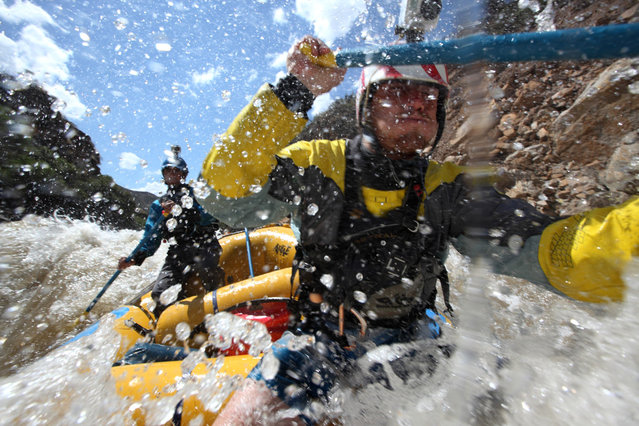 August 24, 2012. – Rio Mantaro, Peru – Amazon Express white water team members Tino Specht, of the U.S., right, and Juan Antonio De Ugarte, of Peru, drive their raft through rapids in the Rio Mantaro. (Photo by Erich Schlegel/zReportage via ZUMA Press)