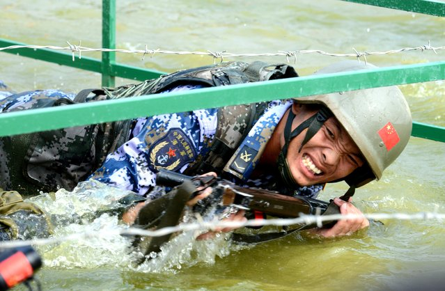 "A Chinese team member competes in the survival trail event of the International Army Games 2018 ""Seaborne Assault"" on August 2, 2018 in Quanzhou, Fujian Province of China. (Photo by Wang Dongming/China News Service/VCG via Getty Images)"