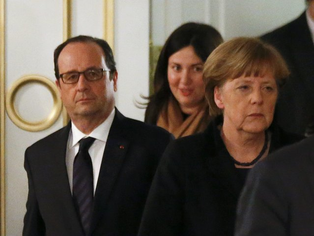 Germany's Chancellor Angela Merkel (R) and France's President Francois Hollande (L) walk as they attend a peace summit to resolve the Ukrainian crisis in Minsk, February 12, 2015. (Photo by Vasily Fedosenko/Reuters)