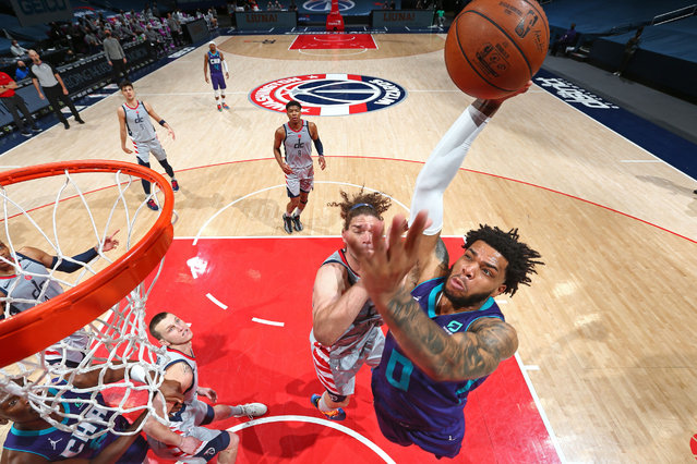 Miles Bridges #0 of the Charlotte Hornets dunks the ball against the Washington Wizards on March 30, 2021 at Capital One Arena in Washington, DC. (Photo by Stephen Gosling/NBAE via Getty Images)