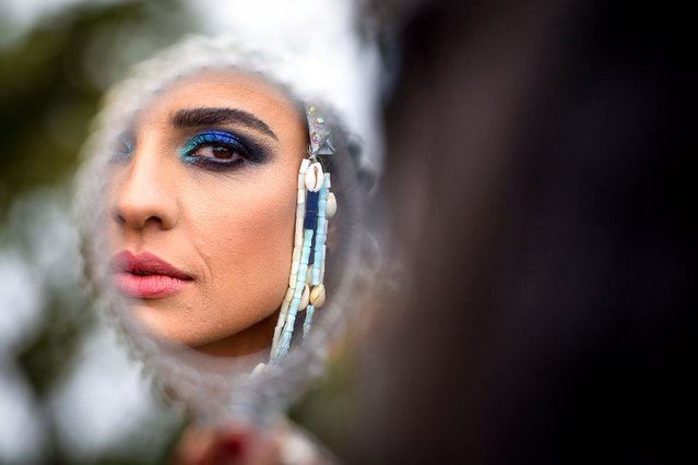 A performer looks in a mirror as she prepares for the Notting Hill Carnival Adults Parade in London, Britain, 27 August 2018. (Photo by Pete Maclaine/EPA/EFE)