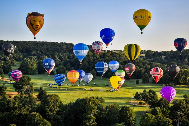 Hot air balloons take off in a mass ascent from Bristol on August 3, 2020, with 43 balloon teams taking part, for a Fiesta Flypast over the city as part of the socially distanced alternative to the Bristol International Balloon Fiesta 2020. (Photo by Ben Birchall/PA Images via Getty Images)