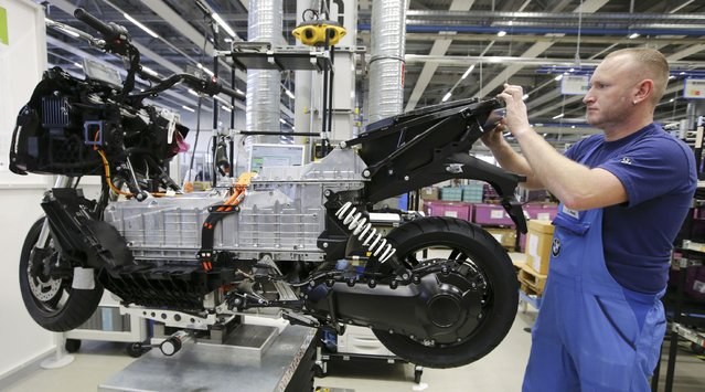 A mechanic makes a technical check on a BMW C evolution electric maxi-scooter on the production line at the BMW Berlin motorcycle plant February 23, 2015. (Photo by Fabrizio Bensch/Reuters)