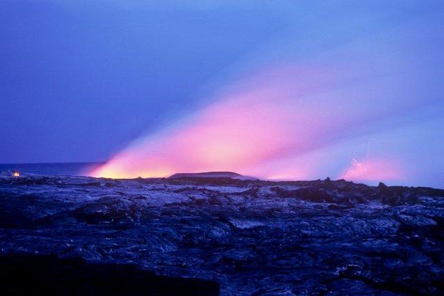 Fluorescent smoke emanates from the Kilauea volcano, in Kilauea, Hawaii. (Photo by Kirk Aeder/Barcroft Media)