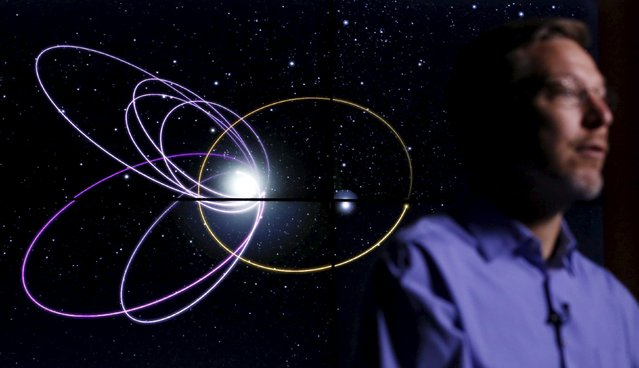 Professor of Planetary Astronomy Mike Brown speaks in front of a computer simulation of the probable orbit of Planet Nine (yellow) at the California Institute of Technology in Pasadena, California January 20, 2016. The solar system may host a ninth planet that is about 10 times bigger than Earth and orbiting far beyond Neptune, according to research published on Wednesday. (Photo by Mario Anzuoni/Reuters)
