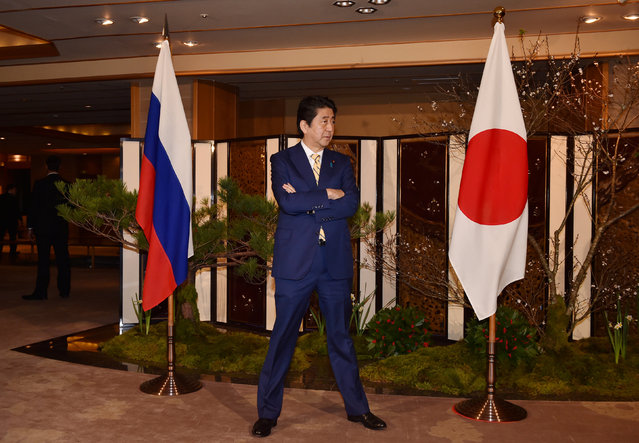 Japanese Prime Minister Shinzo Abe waits for Russian President Vladimir Putin's arrival at a hotel prior to their talks in Nagato, Yamaguchi prefecture on December 15, 2016. (Photo by Kazuhiro Nogi/Reuters)