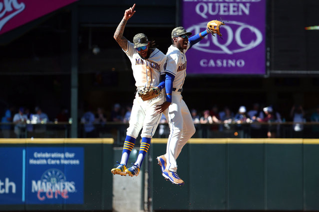 J.P. Crawford #3 (L) and Kyle Lewis #1 of the Seattle Mariners celebrate the 3-2 win against the Cleveland Indians at T-Mobile Park on May 16, 2021 in Seattle, Washington. (Photo by Abbie Parr/Getty Images)