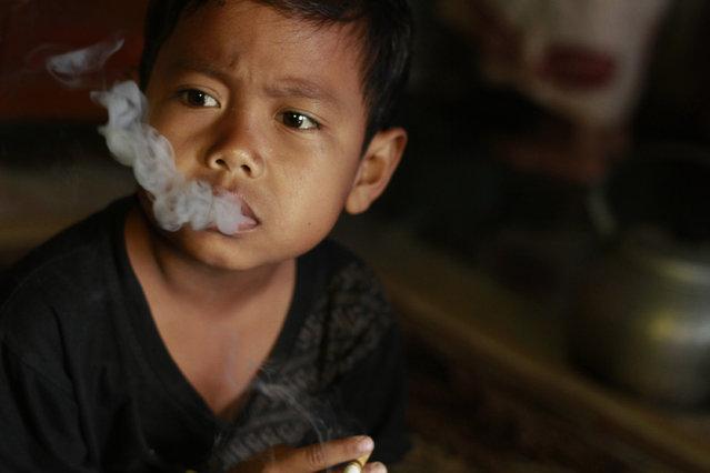 Dihan exhales a cloud of cigarette smoke. (Photo by Rezza Estily/JG Photo)