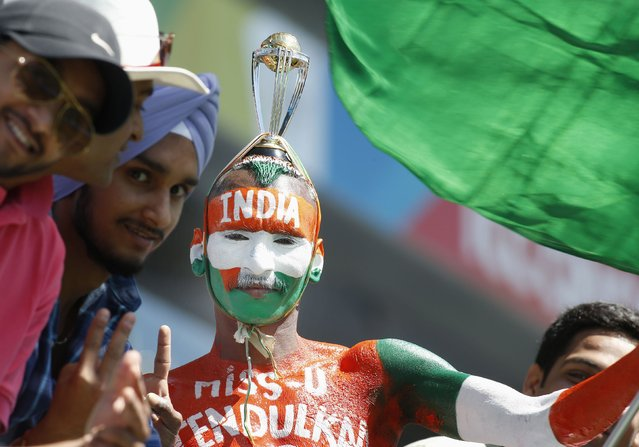 India's fans cheer before the Cricket World Cup match between Zimbabwe and India, at Eden Park in Auckland, March 14, 2015. (Photo by Nigel Marple/Reuters)