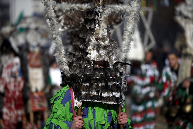 A participant dressed in traditional costume holds his mask during the International Festival of the Masquerade Games in the town of Pernik, Bulgaria January 30, 2016. (Photo by Stoyan Nenov/Reuters)
