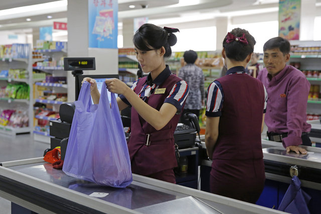 In this September 12, 2018 photo, North Korean shop assistants work at a supermarket in Pyongyang, North Korea. In the era of Kim Jong Un, North Korea is learning to embrace its inner consumer. The rise of the consumer is a major feature, not a bug, of Kim's plans to strengthen the country's sad-sack economy and lift the people's standard of living. (Photo by Kin Cheung/AP Photo)