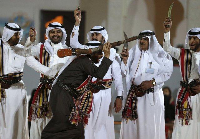 Saudi man performs a traditional dance during Janadriyah Culture Festival on the outskirts of Riyadh, Saudi Arabia February 8, 2016. (Photo by Faisal Al Nasser/Reuters)