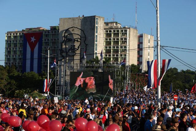 "People march under an image of Cuba's late President Fidel Castro to mark the Armed Forces Day and commemorate the landing of the yacht Granma, which brought the Castro brothers, Ernesto ""Che"" Guevara and others from Mexico to Cuba to start the revolution in 1959, in Havana, Cuba, January 2, 2017. (Photo by Alexandre Meneghini/Reuters)"