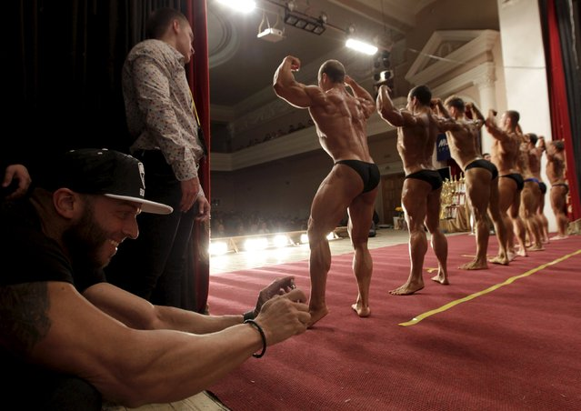 A man takes pictures during a regional bodybuilding and fitness competition in Stavropol, southern Russia April 4, 2015. (Photo by Eduard Korniyenko/Reuters)