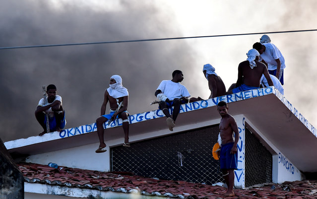 Inmates are seen on a roof during an uprising at the Alcacuz prison in Natal, Rio Grande do Norte state, Brazil, January 19, 2017. (Photo by Josemar Goncalves/Reuters)