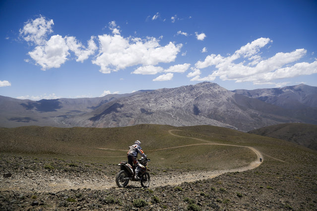 KTM rider Alain Hermet of France races during the third stage of the Dakar Rally between the cities of San Rafael and San Juan, Argentina, Tuesday, January 7, 2014. (Photo by Victor R. Caivano/AP Photo)