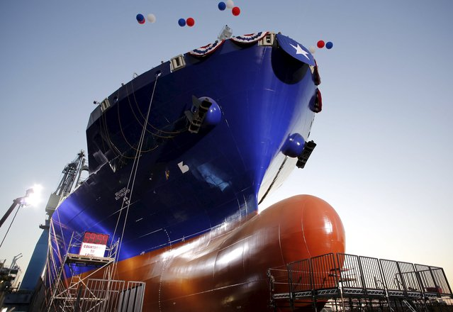 The Isla Bella, the first container ship to be powered by liquid natural gas, is pictured before her launch during a nighttime ceremony at General Dynamics NASSCO shipyard in San Diego, California April 18, 2015. The 764-foot Marlin-class containership was built for the transportation and logistics company TOTE. (Photo by Earnie Grafton/Reuters)