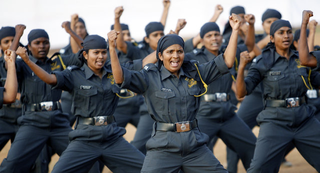 Indian women commandos perform martial arts exercises during a function to mark the founding day of Maharashtra, in Mumbai, May 1, 2008. (Photo by Arko Datta/Reuters)